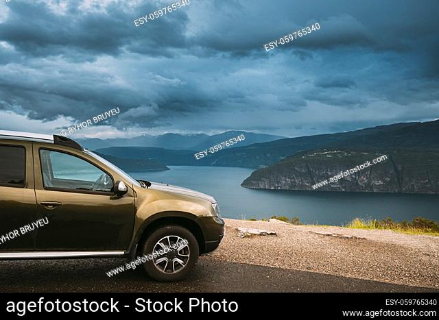 Utvik, Sogn Og Fjordane County, Norway. Car Suv Parked Near Scenic Route Road In Norwegian Mountain Lake Landscape. Innvikfjord Is A Sub-fjord Of Nordfjord In...