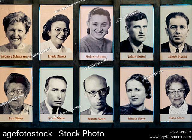 Krakow, Poland - May 16, 2019: Portraits of Jewish people saved bij Oskar Schindler. Memorial wall in Krakow Museum Schindler's Factory in WW2