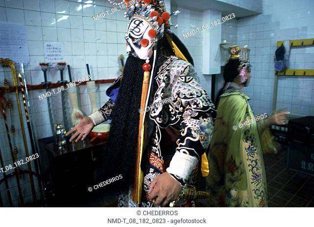 Close-up of opera performers in a dressing room, China