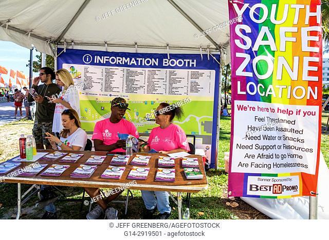 Florida, Miami Beach, Lummus Park, Gay Pride Week, LGBTQ, LGBT, Miami Beach Pride Festival, information booth, Youth Safe Zone, Black, man, volunteer