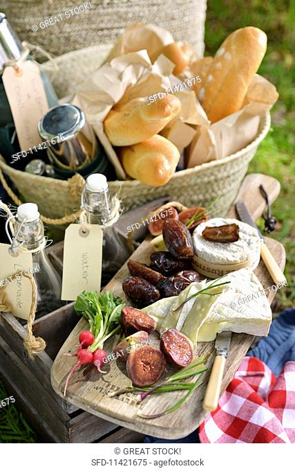 A winter picnic in South Africa with cheese, bread and figs