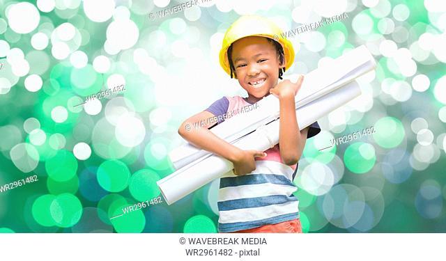 Happy girl holding blueprints against bokeh