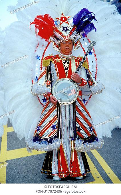 costume, parade, banjo, Philadelphia, PA, Pennsylvania, A member of a String Band dressed in an ornate patriotic costume holds his banjo in the Mummers Day...