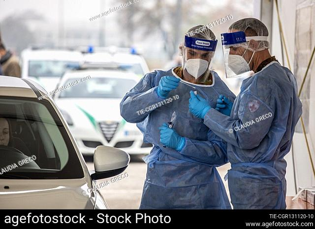 Military and army health workers while take a swab in the drive through area of Novara street car park , Milan, ITALY-13-11-2020
