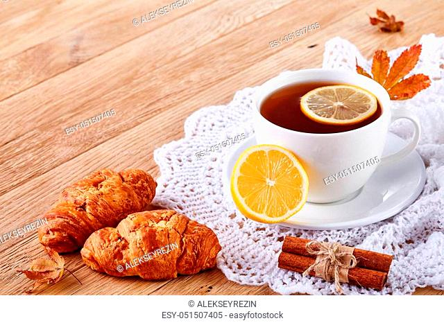 white cup of tea with cookies on a wooden background white cup of tea with cookies on a wooden background. With copy space
