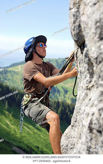 young climber in Bavarian alps, near mountain Blankenstein, south of Germany