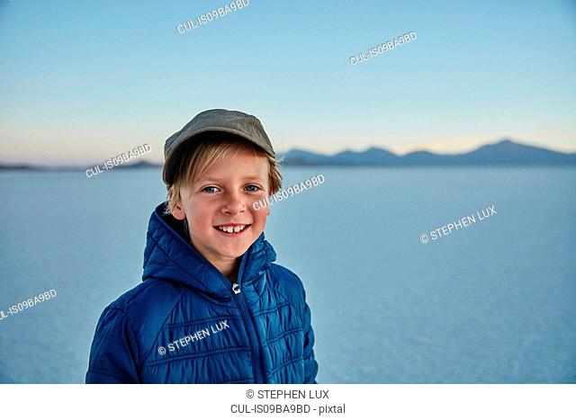 Portrait of boy on salt flats, Salar de Uyuni, Uyuni, Oruro, Bolivia, South America
