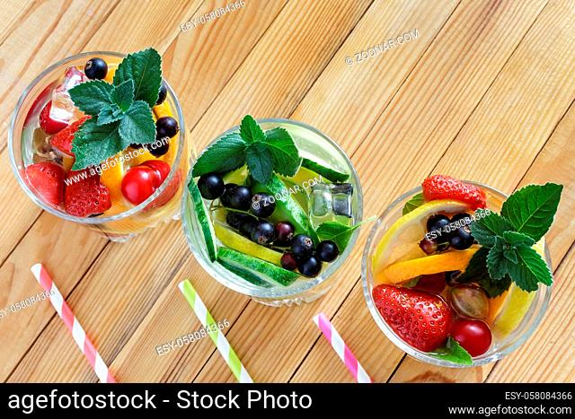Summer refreshing cocktail of natural fruits and various berries with ice and mint leaves infused with water. Contains lemon, orange, strawberry, cherry