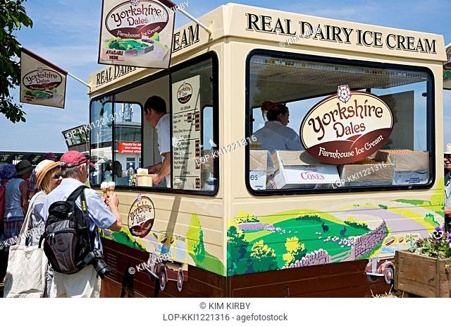 England, North Yorkshire, Harrogate. A couple buy ice cream from a van at the Great Yorkshire Show