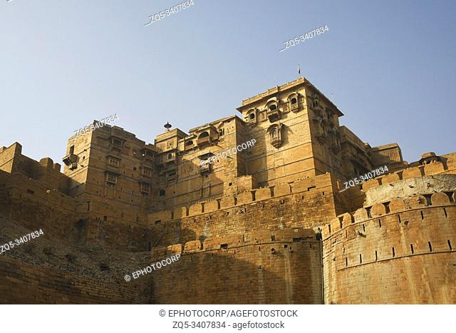 Stone walls of fortification and viewing windows carved in walls at Golden Fort at Jaisalmer in Rajasthan, India