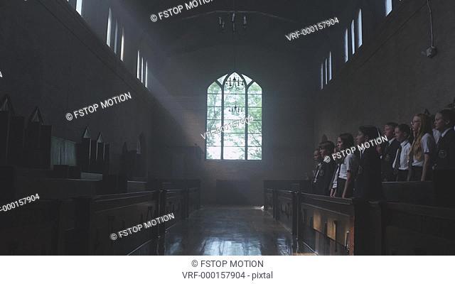 WS, Lockdown, A teenage boy joining a choir of school children in a church