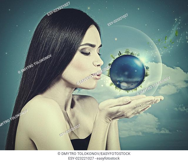 Blue Planet in her hands, abstract eco backgrounds