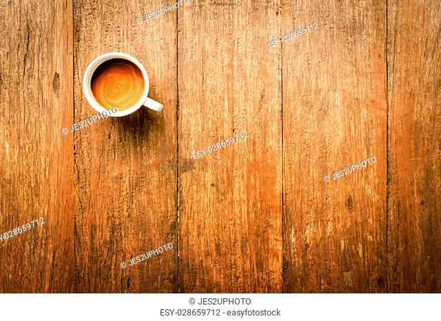 Top view of Coffee Mug on Wooden Table