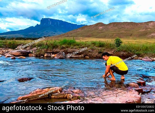 Man relaxing in nature. Mount Roaima, Venezuela