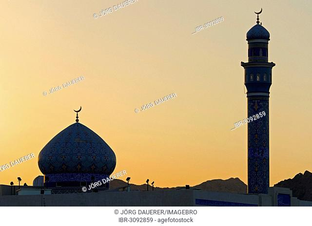 The back-lit minaret and dome of the Rasool Azam Mosque