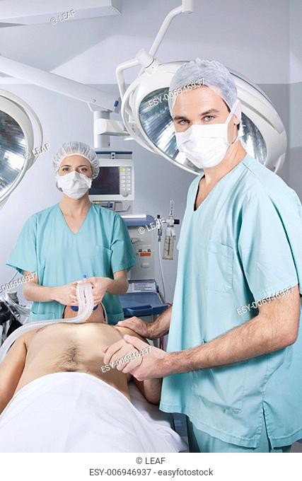 Surgeon nursing the patient before the operation in hospital