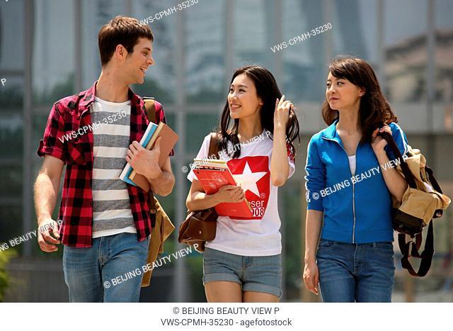 Three university students in campus