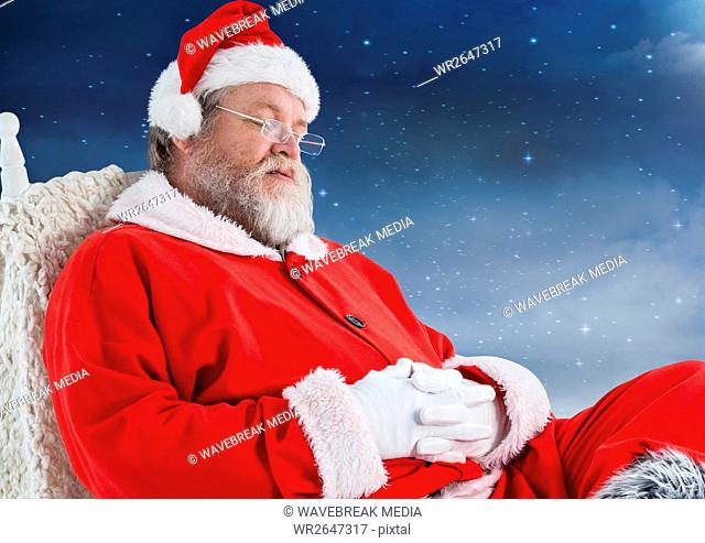Santa claus sitting on chair and sleeping