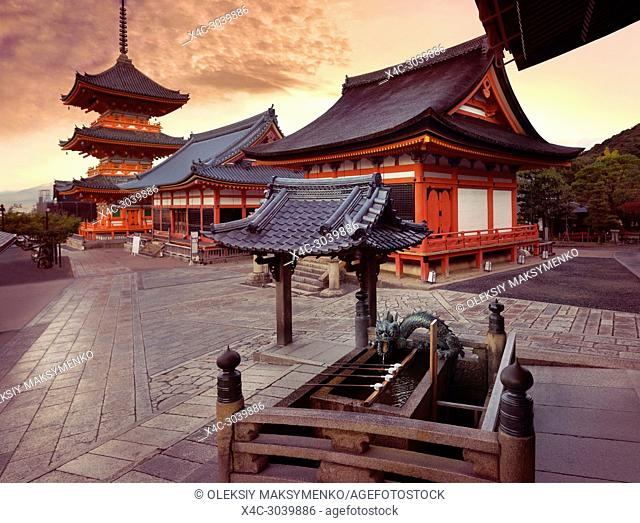 Beautiful sunrise scenery of Kiyomizu-dera Buddhist temple buildings. Chozubachi, water ablution pavilion, basin for a cleansing ritual, chozuya