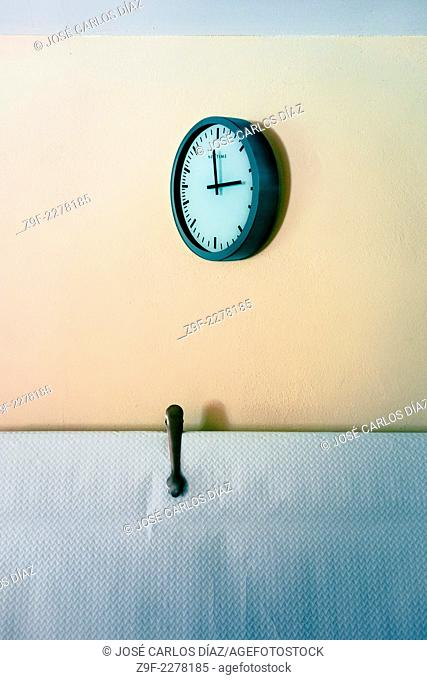 Clock, tablecloth and ice tongs in restaurant, Oropesa, Castellon province, Comunidad Valenciana, Spain
