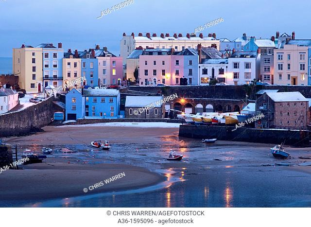Winter snow at Tenby Harbour Tenby Pembrokeshire Wales at twilight