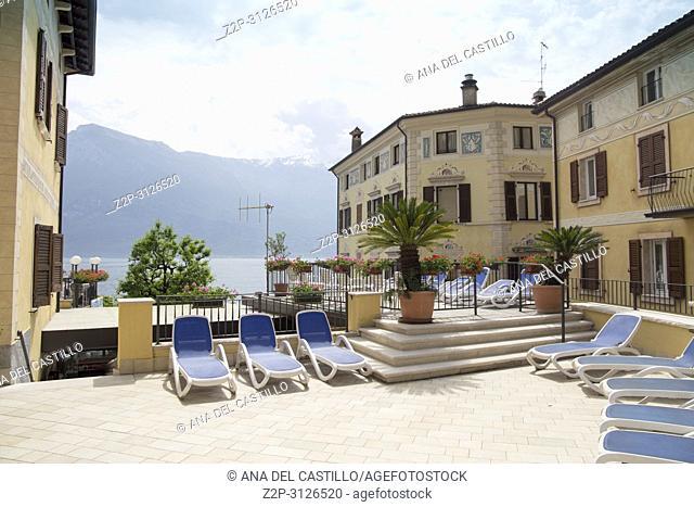 Sun beds. Limone sul Garda town in Lake of Garda, Lombardy, Italy
