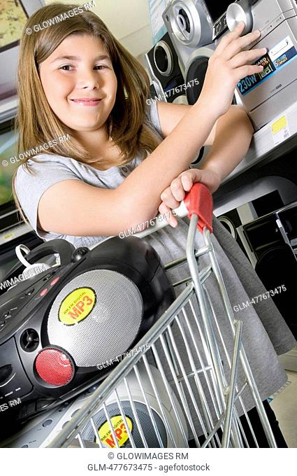 Girl shopping stereos in a supermarket