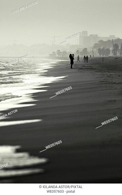 Walking on the beach in winter. Catalonia. Spain