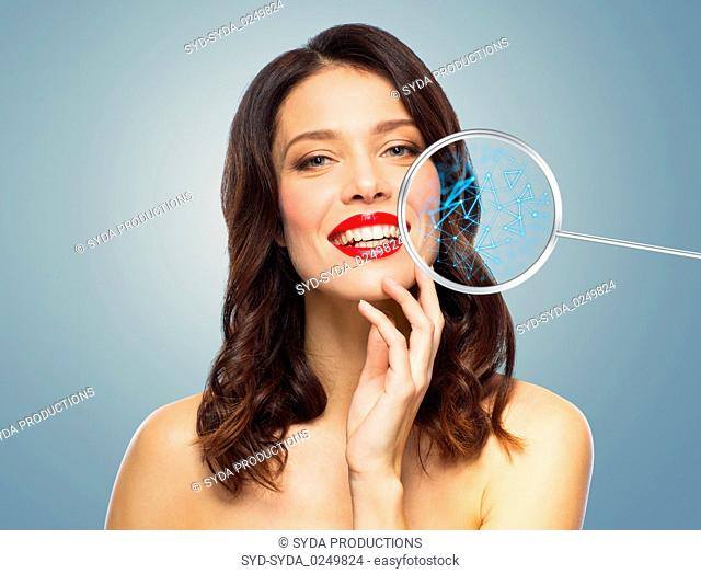 beautiful smiling woman with magnifying glass