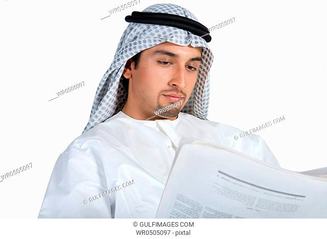 Young man reading newspaper