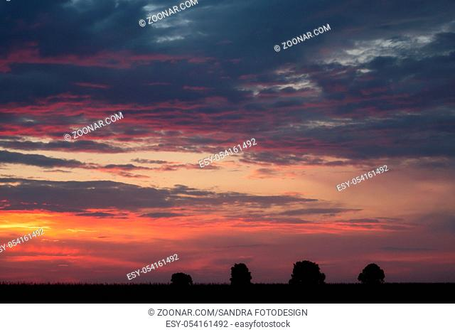 Romantic sunset with black silhouette in the foreground