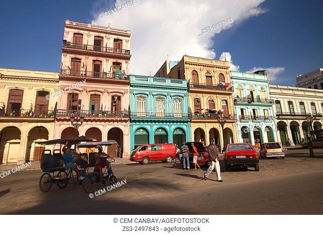 Street scene with bici taxis and colonial houses in Central Havana, Cuba, West Indies, Central America