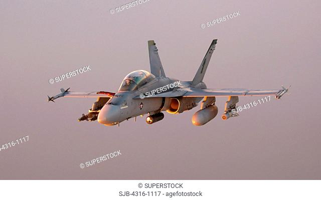 Air to Air View of a US Marine Corps F/A-18D Hornet Miles Above the Al Anbar Province of Iraq at Sunset During a Combat Operation