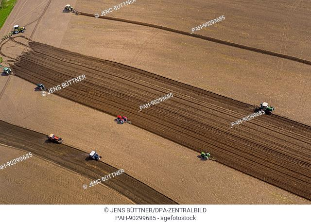 Historical tractors plow a field at the classic vehicle field day in Pokrent, Germany, 01 May 2017. Collectors of old agricultural devices meet already for the...