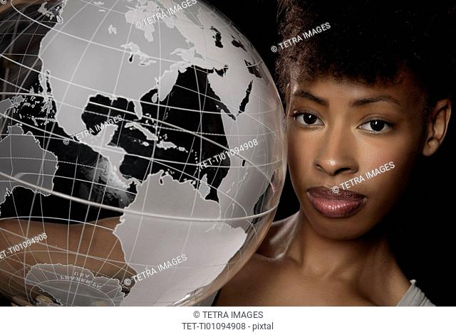 Young woman with transparent globe