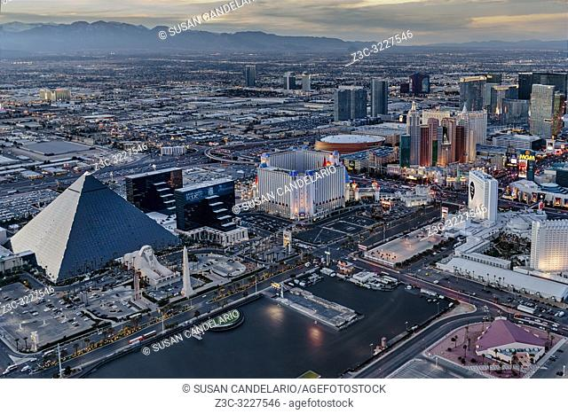 Vegas Strip Aerial - Aerial view of the illuminated Las Vegas Strip with the iconic landmark of the Luxor hotel among many others