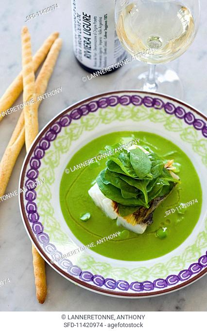 Fish fillet in pea sauce with spinach