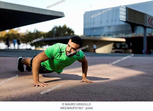 Sportive man during workout, pushup