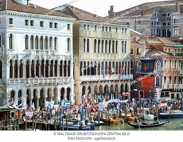 Gondolas and small boats travel on the Canal Grande passing the town hall between Palazzo Loredan (L) and Farsetti (R) in Venice, Italy, 09 September 2014