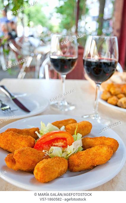 Croquettes serving with red wine. Spain