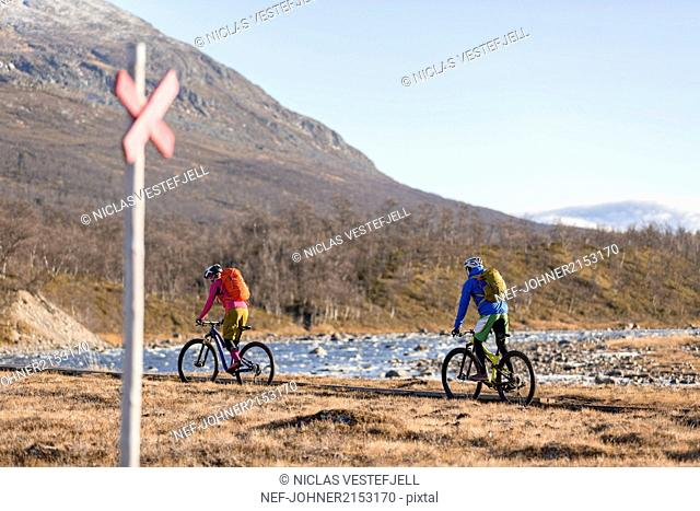 People cycling in mountains