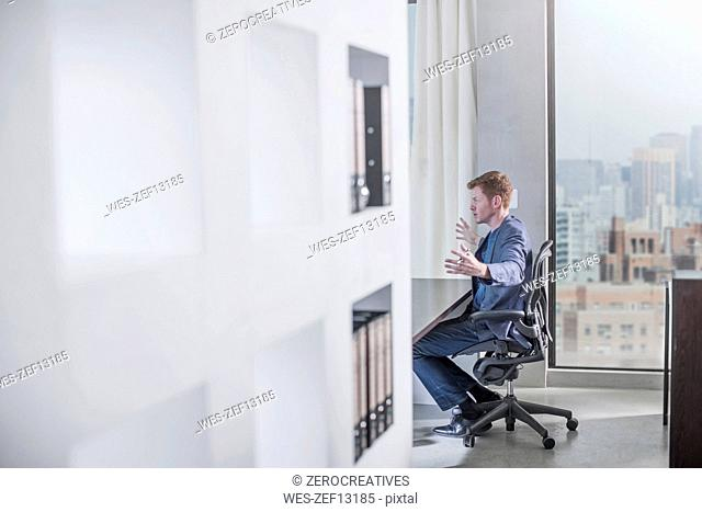 Man sitting at desk in city office