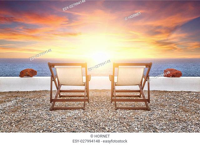 Two sunbathing in front of sunset