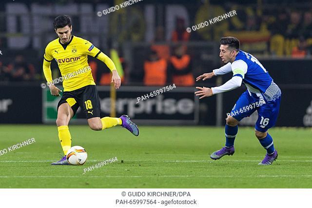 Dortmund's Nuri Sahin (L) vies for the ball with Porto's Hector Herrera (R) during the UEFA Europa League between Borussia Dortmund and FC Porto at Signal Iduna...