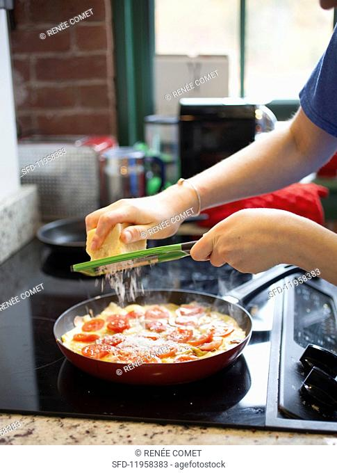 Tomato and Parmesan frittata being made