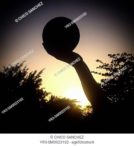 A player of Pok ta Pok, the Mayan Ball Game, holds the ball in Chapab, Yucatan, Mexico