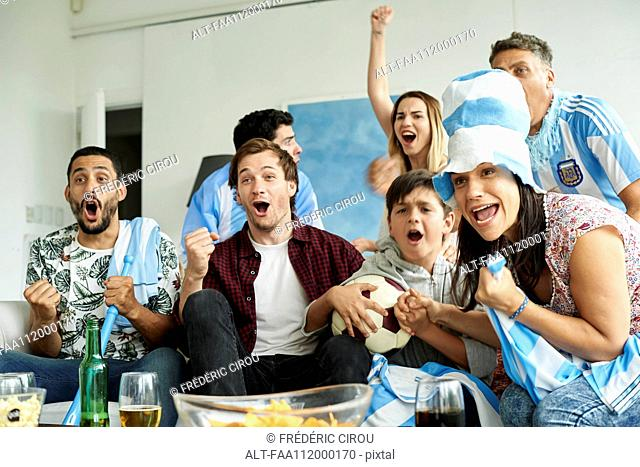 Argentinian football fans watching football match at home