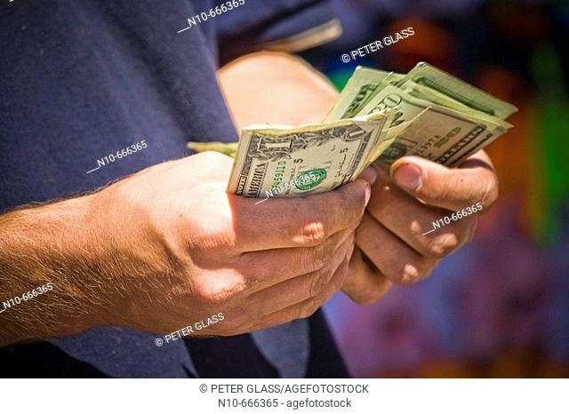 Close-up of a man's hands holding money