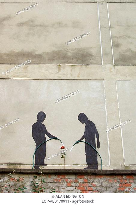 England, Tyne and Wear, Newcastle Upon Tyne, Urban art of two children watering a flower