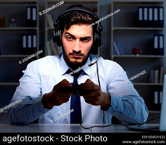 The businessman gamer staying late to play games